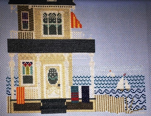 Close up of A Summer Place Cross-Stitch kit. umber 264